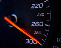 Car speedometer needle is approaching to the maximum value 300 km/h